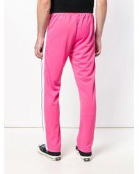 Side-striped track pants di Palm Angels in Pink da Uomo