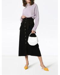Jupe mi-longue Alma en jean Nanushka en coloris Black
