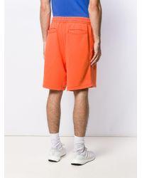 メンズ Moschino プリント トラックパンツ Orange