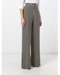 Etro - Black Stripes Flared Trousers - Lyst