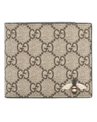 09f67b20477bd Lyst - Gucci Bee Print Gg Supreme Billfold Wallet in Brown