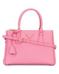 506315e54f Lyst - Prada - Brand Embellished Tote Bag - Women - Calf Leather ...