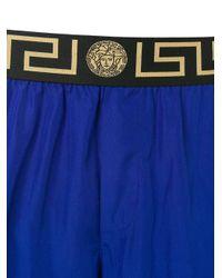 Short de bain à logo Versace pour homme en coloris Blue