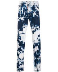 Jean slim à imprimé tie dye DSquared² pour homme en coloris Blue