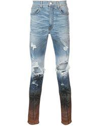 Amiri Blue Distressed Skinny Jeans for men