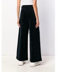 Pantalon ample en velours côtelé Ganni en coloris Blue