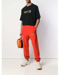 メンズ Heron Preston ロゴ トラックパンツ Orange