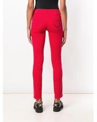 Pantaloni skinny di Love Moschino in Red
