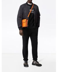 Burberry Triple Stud Grainy Leather Crossbody Bag in Orange für Herren
