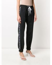 Pantaloni sportivi con bande laterali di Miu Miu in Black