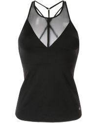 Top sin mangas de malla Alo Yoga de color Black