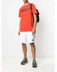 Pantalones cortos de deporte con logo Moschino de hombre de color White