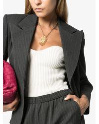 Collier à pendentif logo Gucci en coloris Metallic