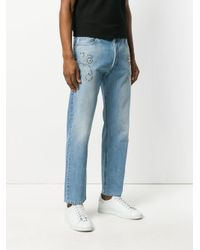 Versace Blue Studded Straight Jeans for men