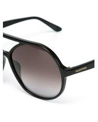 Lunettes de soleil ovales Valentino Garavani Valentino Garavani en coloris Black
