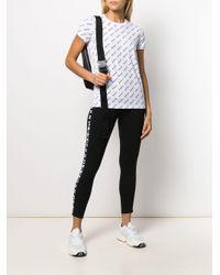 T-shirt à logo imprimé DKNY en coloris White
