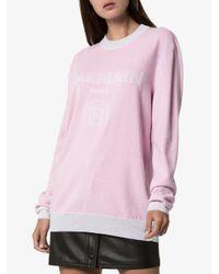 Pull à logo intarsia Balmain en coloris Pink