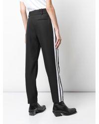 Pantalones con detalle de raya lateral Haider Ackermann de color Black