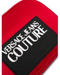 Sac porté épaule à logo contrastant Versace Jeans en coloris Red