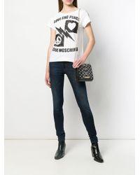 Jeans skinny Heart con logo di Love Moschino in Blue
