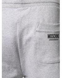 Pantaloni sportivi con banda laterale di Moschino in Gray da Uomo