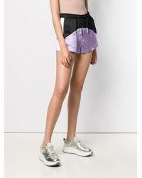 Short bicolore à ceinture élastique Marcelo Burlon en coloris Purple