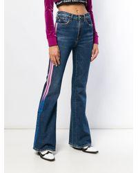 Jeans svasati con righe laterali di Marcelo Burlon in Blue