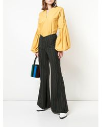 Staud Black Pinstriped Flared Trousers