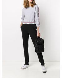 Maglione corto con banda logo di Moschino in Gray