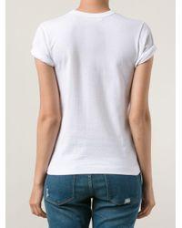 COMME DES GARÇONS PLAY White T-Shirt mit aufgesticktem Herz