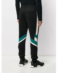 Pantalon de jogging à rayures contrastantes Fila pour homme en coloris Black