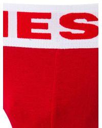 Slip à bande logo DIESEL pour homme en coloris Red