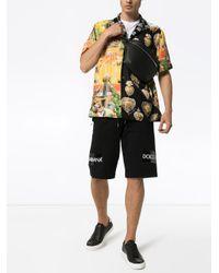 Bermuda à logo et taille élastique Dolce & Gabbana pour homme en coloris Black