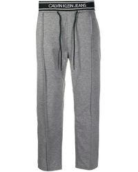 Pantaloni sportivi con banda laterale di Calvin Klein in Gray da Uomo