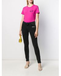 Off-White c/o Virgil Abloh Pink T-Shirt mit grafischem Print