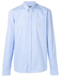 Chemise à logo poitrine brodé Balmain pour homme en coloris Blue
