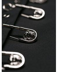 Minigonna con spille di Versus  in Black
