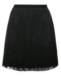 Minijupe à franges Saint Laurent en coloris Black