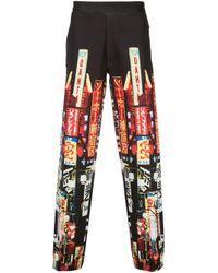 Pantalon de jogging imprimé Neil Barrett pour homme en coloris Black