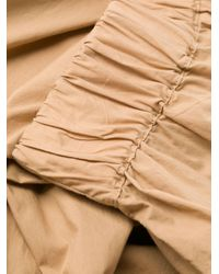 Pantaloni crop a gamba ampia di Woolrich in Natural