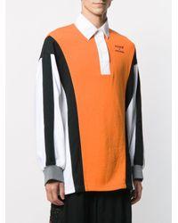 Polo oversize x Converse Koche de color Orange