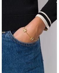 Bracelet à breloques logo Chanel Pre-Owned en coloris Metallic