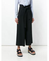 Jupe culotte ceinturée Stella McCartney en coloris Black
