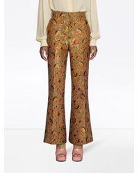 Pantalon imprimé à design évasé Gucci en coloris Brown