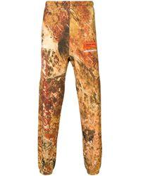 Pantalon de jogging imprimé Heron Preston pour homme en coloris Red