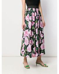 Jupe longue à fleurs Dolce & Gabbana en coloris Black