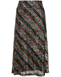 Jupe mi-longue à sequins brodés MILLY en coloris Black