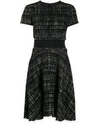 Flared tweed dress di Paule Ka in Black