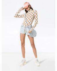 Shorts denim mini con ricamo di MIRA MIKATI in Blue