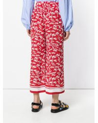 Miu Miu Red Logo Graffiti Print Trousers